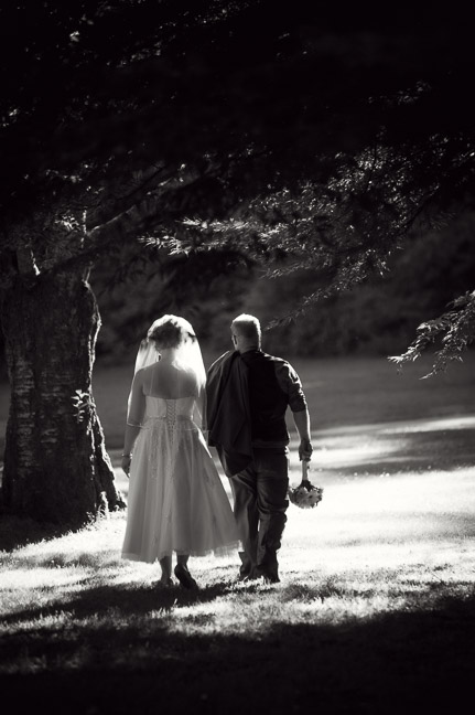 bridal-couple-walking-forest