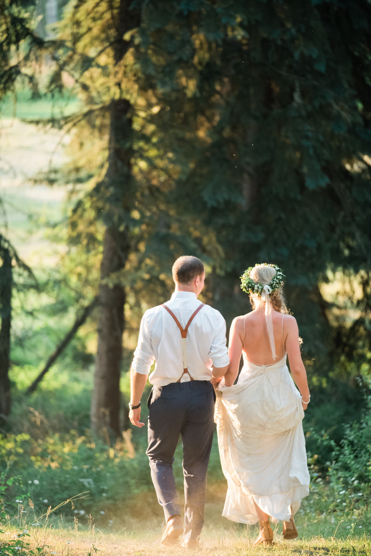 Sunshine Ranch wedding bride and groom walking in the sunset