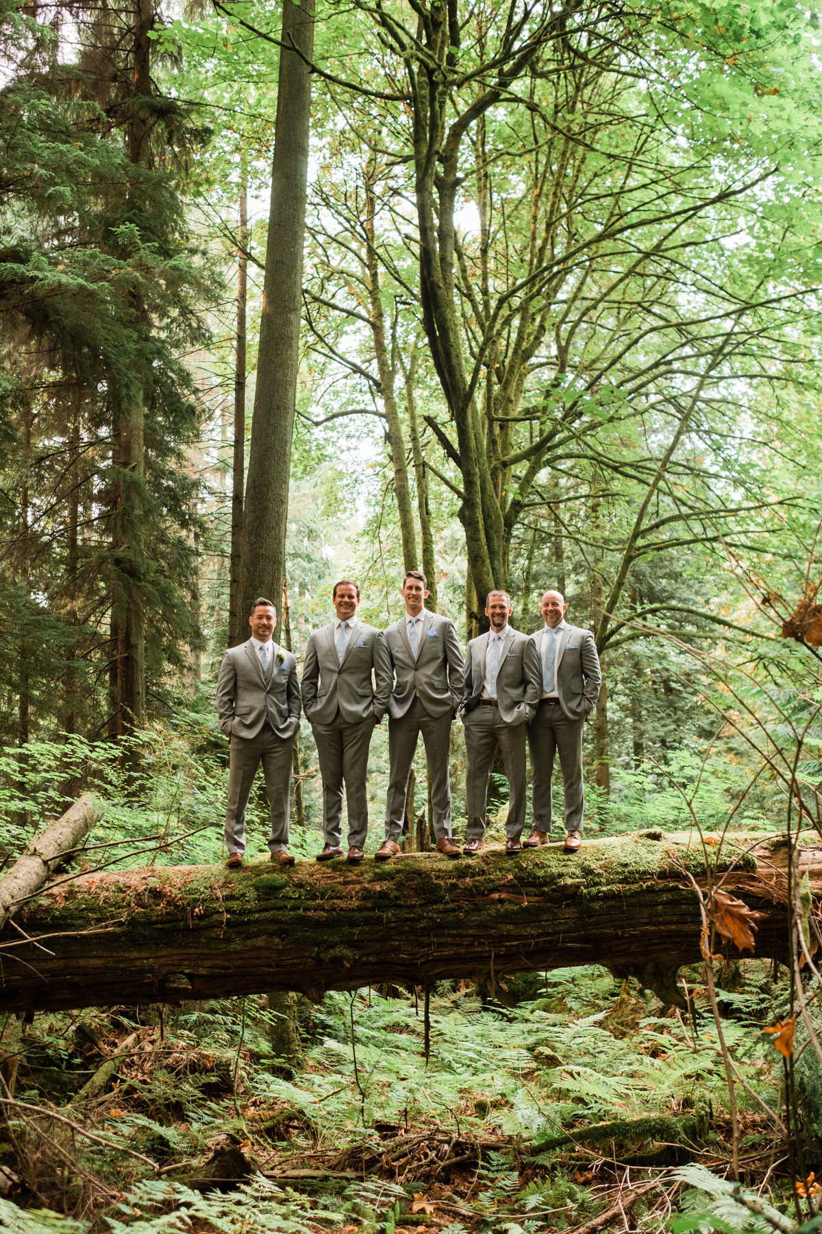 Stanley Park Pavilion wedding groommen on a tree